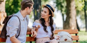conversation between young couples in a park