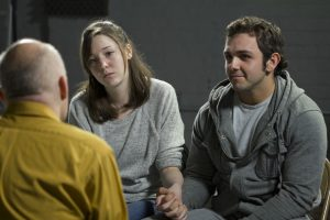 couples holding hands in a therapy session