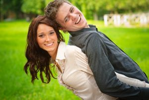 playful happy couple in a park